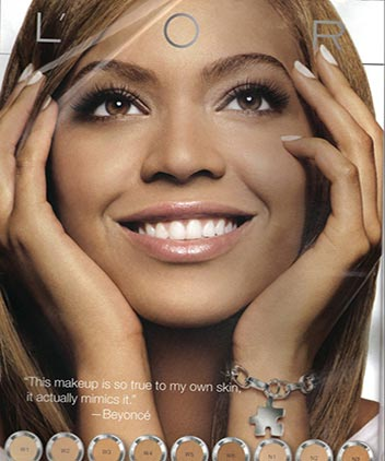Music celebrity Beyonce Knowles' brown colored eyes in l'oreal close-up photo advertisement